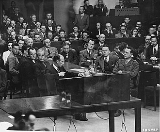 Henry T. King - The prosecution team at the Trial of Erhard Milch. Front right is Telford Taylor (Chief Counsel). Across the table from him is Clark Denny (Chief Trial Counsel). Immediately to Taylor's right is Henry T. King (Assistant Counsel).