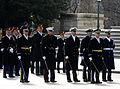 Military officers stand at ease while waiting to perform their pass in review during the 57th Presidential Inauguration 130121-F-AV193-077.jpg