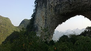 Moon Hill - A rock climber on the Moon Hill arch
