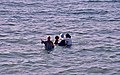 Morocco - 3 women bathing in sea with clothes on.jpg