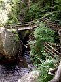 Mountain wooden bridge over the water.jpg