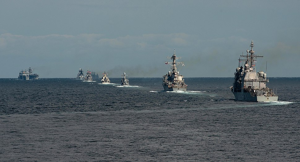Multinational ships steam in formation during an exercise at the RoK international Fleet Review 2018 - 181011-N-DK042-0154