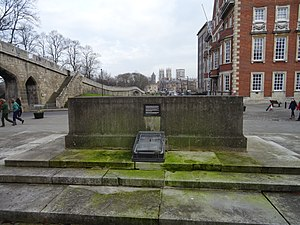 North Eastern Railway War Memorial - The rear of the Stone of Remembrance, viewed from the main part of the memorial. The NER's former headquarters is to the right and York's city walls are to the left; York Minster is visible in the background.