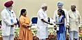Narendra Modi giving away awards to the winners of national essay, painting and film competitions (4).jpg