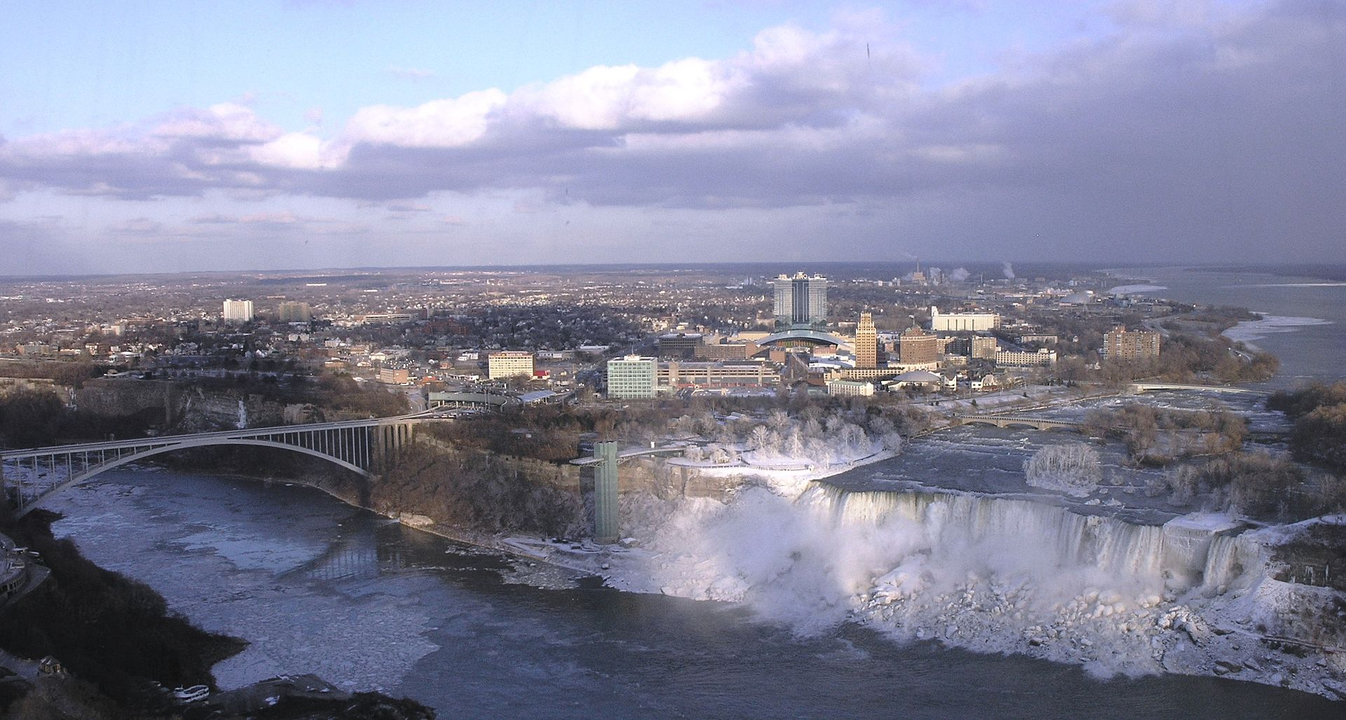 The city of Niagara Falls. In the foreground are the waterfalls known as the American Falls and Bridal Veil Falls, respectively, from left to right.