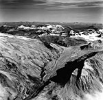 Noisy Mountain Glacier, terminus of mountain glacier, and arete peaks in the background, August 26, 1969 (GLACIERS 7044).jpg