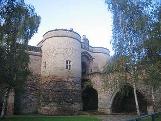 Nottingham Castle - The Castle Gate House shows the medieval architecture of the bridge and lower towers against the Victorian renovation of the upper towers and gate house