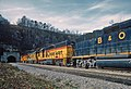 One C&O Train Coming Out of and One Going Into Fort Springs Tunnel -- 5 Photos (31995261991).jpg