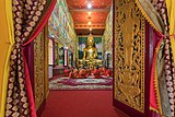 Open front door over Wat Mixay and praying bhikkhus, Vientiane, Laos.jpg