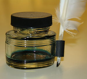 Nib (pen) - Quill pen and ink bottle.