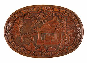 Carved lacquer - Tuoyuan pan (oval tray) with people in a landscape, 24.5 cm wide, Yuan