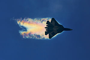 Fifth-generation jet fighter - Sukhoi Su-57 (T-50) creating aerodynamic condensation at MAKS-2015
