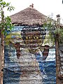 Painted Figure on Corrugated Portal - Near Lalibela - Ethiopia (8735288466).jpg