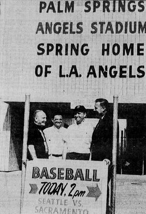 Palm Springs Stadium - Palm Springs Stadium in Palm Springs, California in 1965, formerly the spring training home of the Los Angeles Angels of the Pacific Coast League (PCL). In the image from left to right are Angels general manager Fred Haney, trainer Freddie Frederico, owner Gene Autry and PCL president Dewey Soriano. The signboard the men are standing over is from 1955.