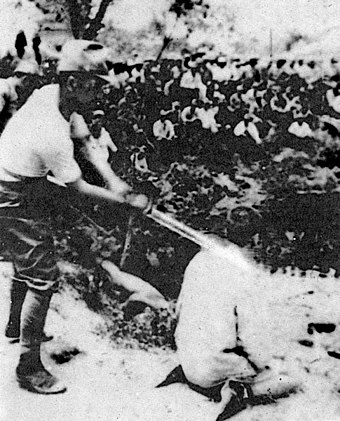 "A Chinese POW about to be beheaded by a Japanese officer with a shin gunto Photo 07 (The ""Shame"" Album).jpg"
