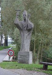 Modern statue of Saint Pirminius on the access dam to the island of Reichenau