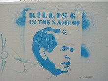 "An image of George W. Bush stencilled in light blue with the words ""Killing in the Name of"" written above it."