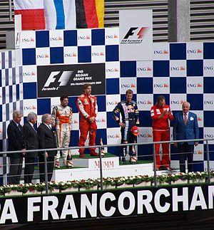 2009 Belgian Grand Prix - The post-race podium ceremony. From left to right: Giancarlo Fisichella, Kimi Räikkönen, Sebastian Vettel and Stefano Domenicali.