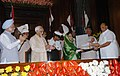 Pratibha Devisingh Patil presenting the Outstanding Parliamentarian Award to the Union Minister of Consumer Affairs, Food and Public Distribution and Agriculture, Shri Sharad Pawar, in New Delhi on September 13, 2007.jpg