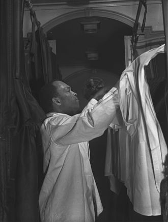 Brotherhood of Sleeping Car Porters - A Pullman Porter making the bed of an upper berth, 1942.
