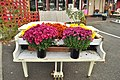 Puyallup, WA - Piano used for flower arrangement outside Butterfly Boutique.jpg