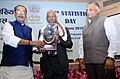 Radha Mohan Singh presenting the National Statistics Award, at the celebrations of the 10th National Statistics Day 2016, on the theme 'Agriculture and Farmers Welfare', in New Delhi.jpg