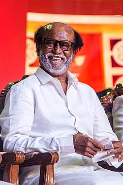 Rajinikanth is seen looking away from the camera.