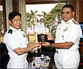 Rear Admiral RJ Nadkarni presenting a memento to the visiting Myanmar Navy delegation.jpg