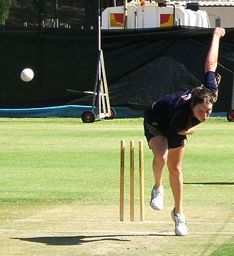 Rene Farrell - Farrell follows through after delivering a ball in the nets.