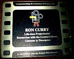 Photo of Ron Curry film cell plaque