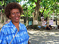 Rose sells handicrafts in downtown Honiara. Woven bags hanging from the trees in the background. (10717640483).jpg