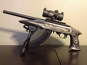 Ruger 10/22 - Ruger Charger. Comes with bipod. Shown with aftermarket TruGlow multi-color reflexive dot scope and Ruger BX-25 extended magazine.