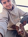 Ryan Kuster with a calf (38975236745).jpg