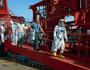 Gemini 2 - The prime and backup crews for Gemini 3, John Young (suited), Wally Schirra, Thomas P. Stafford (in shirtsleeves), and Gus Grissom (suited), practice egress from the Gemini 2 pad, in preparation for the upcoming Gemini 3 flight