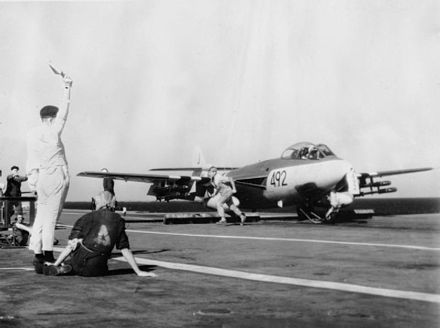 A Hawker Sea Hawk of 899 Naval Air Squadron, armed with rockets, about to be launched from the aircraft carrier HMS Eagle for a strike on an Egyptian airfield Sea Hawk 899 NAS on cat HMS Eagle (R05) Suez 1956.jpg