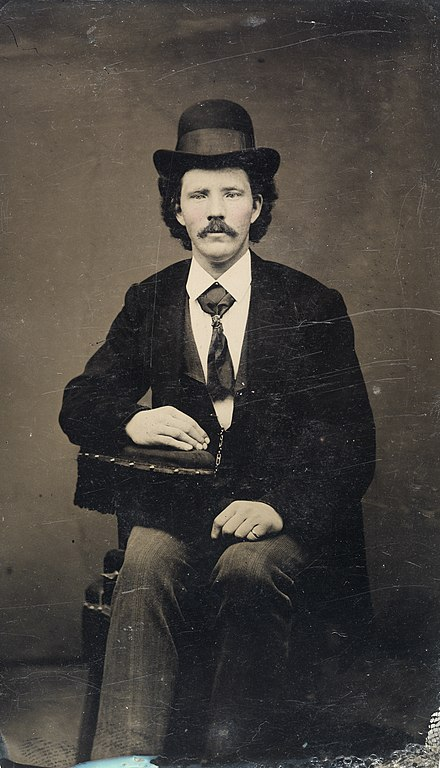 fileseated man with bowler hat ca 18561900