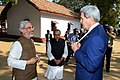 Secretary Kerry grasps cotton necklace given to him upon arrival at Gandhi's Sabarmati Ashram.jpg