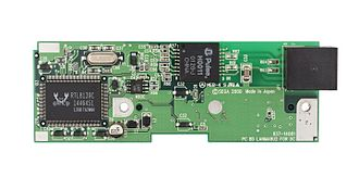 Realtek - A RTL8139C chip as seen on a broadband adapter for a Sega Dreamcast video game console.