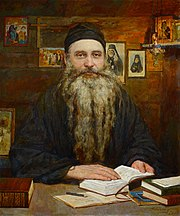 Painting of Seraphim Rose sitting at a desk in a cabin with an open book