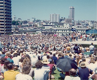 Labor Party policy launch before a crowd in the Sydney Domain on 24 November 1975. Shame Fraser Shame - ALP policy launch 24 November 1975 (16268632954).jpg