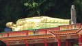Sleeping Buddha outside the temple.png