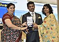 Smriti Irani presenting the Rajat Kamal Award to Farha Khatun (Best Film on Social Issues) for the Non-Feature film – I AM BONNIE (Shared), at the 65th National Film Awards Function, in New Delhi.JPG
