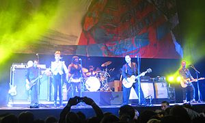Social Distortion - Social Distortion performing songs from Hard Times and Nursery Rhymes with backing vocalists Dessy Di Lauro (second from left) and Ijeoma Njaka (third from left)