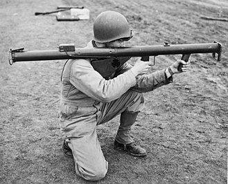 Rocket launcher - An American soldier aims an M1 Bazooka.