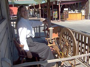 Pop Goes the Weasel - Spinner Charlene Parker with weasel (on left) and spinning wheel (on right) at Knott's Berry Farm