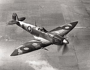 "Supermarine Spitfire (late Merlin-powered variants) - This Spitfire HF Mk VII EN474 was tested by the USAAF and is now housed at the Smithsonian National Air and Space Museum, the only surviving example of a Mk VII. Note the ""pointed"", extended wingtips and the cabin pressurisation air intake under the exhausts."