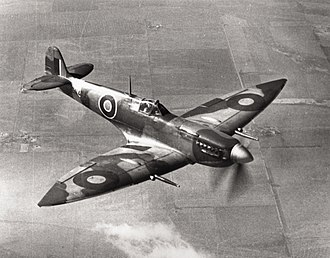 """Supermarine Spitfire (late Merlin-powered variants) - This Spitfire HF Mk VII EN474 was tested by the USAAF and is now housed at the Smithsonian National Air and Space Museum, the only surviving example of a Mk VII. Note the """"pointed"""", extended wingtips and the cabin pressurisation air intake under the exhausts."""