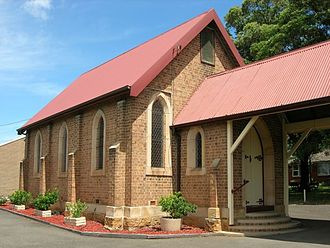 Ermington, New South Wales - St Marks Anglican Church. Part of the original sandstone wall can be seen at its base.