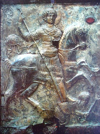 "Byzantine army (Komnenian era) - Though Georgian, this 11th century icon of St. George shows the type of armour most often depicted as being worn by Byzantine heavy cavalrymen of the Komnenian period. Despite being superficially ""Classical"" in appearance the armour is in fact contemporary: a lamellar klivanion cuirass with tubular splint defences for the upper arms and the kremasmata, a splinted 'skirt,' to protect the hips and thighs; the boots are of a typical knee-length Byzantine type employed by cavalry."