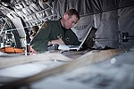 Staff Sgt. Charles Kirchen inspects pallets of boron on C-130.jpg